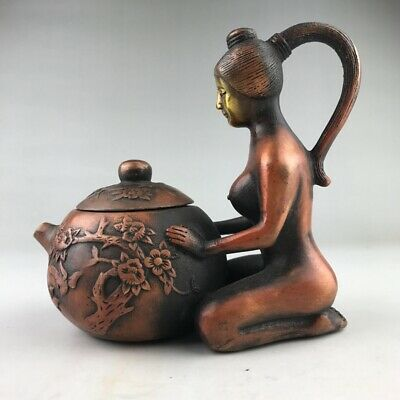 An image of a woman handcrafted from an ancient copper wine pot in China