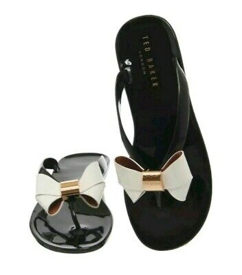 6abadf02e33f TED BAKER ETTIEA Black and Cream Bow Flip Flops. Size 6 - £32.99 ...