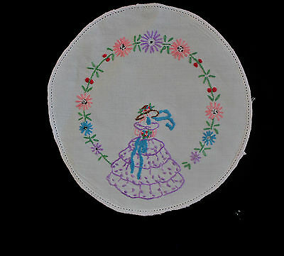 Vintage white linen hand embroidered crinoline lady cloth/doily.