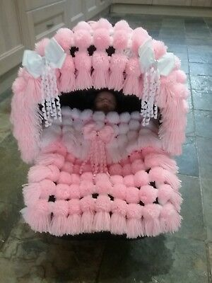 Baby pom pom blanket with hood trim suitable for car seats etc