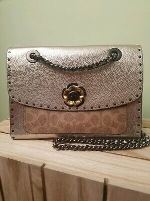 e27eb0af4 COACH Parker In Signature Canvas With Rivets And Snakeskin Detail $450
