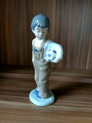 Lladro hand made in Spain by lladro Nao daisa 1988 Boy with football