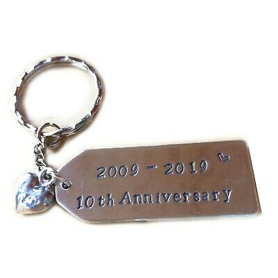 10th Anniversary Keyring stamped 2009-2019 with Tin Heart Charm Attached.