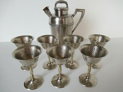 Vintage barware: Art Deco martini shaker + 7 coupes in hammered silver
