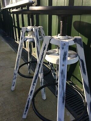 A pair of Upcycled Reclaimed Contemporary adjustable stools in black and white