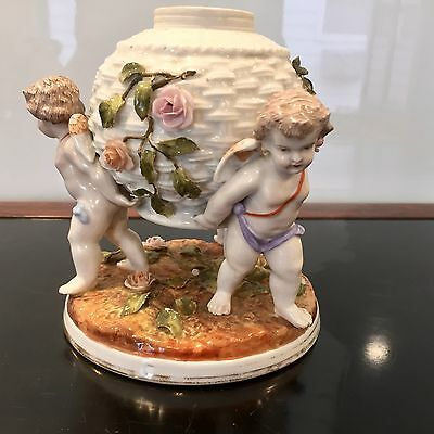 19Th Century Sitzendorf Dresden Porcelain Figure Of Three Putti's Holding An Urn