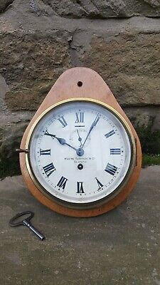 A brass bulkhead clock from the marine instrument makers Whyte Thomson, Glasgow