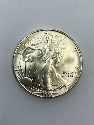 1986 American Silver Eagle. ! 1 Oz., Better Date.! GEM BU.! NR.!