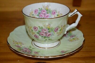 Aynsley tea cup and saucer light green with little pink cabbage roses England