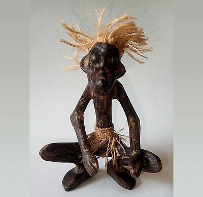 Old hand-carved African carved wooden crouching warrior carving figure