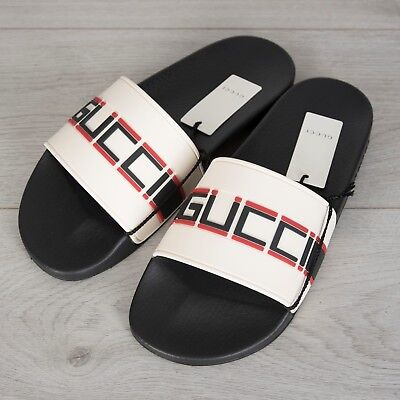 ec49183d7b53 GUCCI 290  Men s Slide Sandals In White Striped Rubber With Black   Red Logo