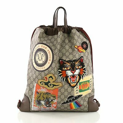 420aca84eb89 Gucci Courrier Soft Drawstring Backpack GG Coated Canvas with Applique  Medium