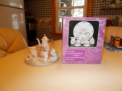 Collectible 10 Piece Porcelain Rose Tea Set with Gold Accent