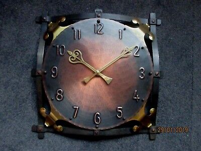 """Junghans  """"Arts and Crafts """" style Wrought Iron  Auto-Mat Wall Clock ."""