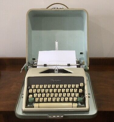 Vintage Olympia De Luxe Portable Typewriter With Case West Germany