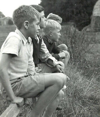Vintage English scouts seated on fence 1960s photo photograph
