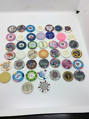 LOT OF 44 mixed DENOMINATION CASINO GAMING CHIPS from various LOCATIONS