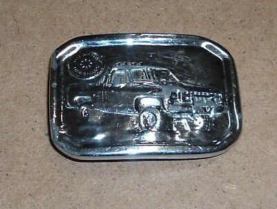 vtg. 1977 indiana metal craft chromed free wheeling four wheeling belt buckle