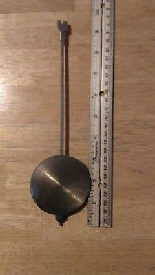 1 Brass in Color  Pendulum. This Is Brass/Metal.  The Bob Is 2 1/2 Inches.