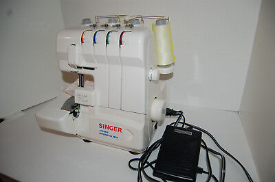 Singer Serger model 14t948ds Mechanical Sewing Machine with instruction manual