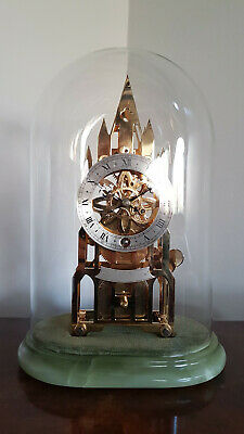 A stunning gilded Skeleton clock by a fine English maker - Elliott of London