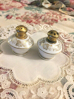 """Antique porcelain salt and pepper shakers, hand painted 2"""" high"""