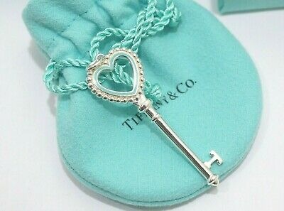 5f4d6585459c Tiffany   Co. Sterling Silver Heart Blue Enamel Key Pendant Charm