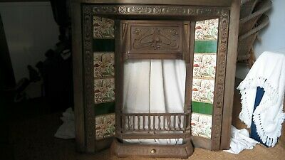 Art nouveau tiled fireplace with lily design tiles