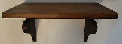 Wide Wood Stained Decorative Wall Shelf With Scroll Design On Braces