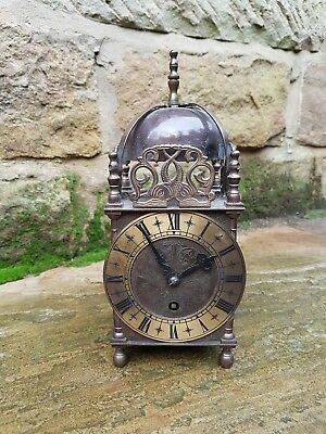 An original Smith's 8 day lantern clock - Working fine jewelled lever escapement