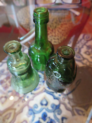 "Wheaton GREEN GLASS miniature bottles set of 3 measuring 3""H"
