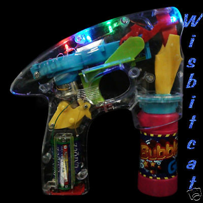 NEW Light Up AUTOMATIC BUBBLE Blowing GUN Blower Favors