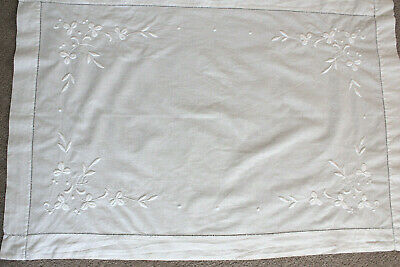 Vintage rectangular white cotton cloth with white embroidery.