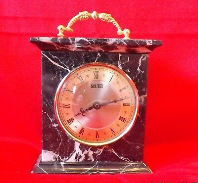 Attractive petite Black variegated marble and gilt carriage clock