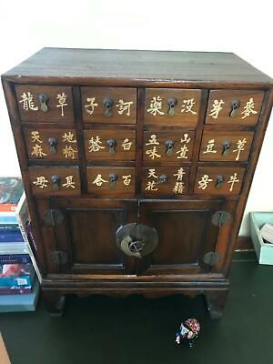 Antique wooden chinese medicine chest with brass details
