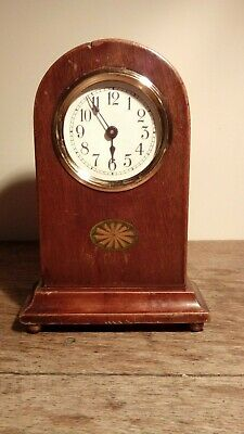 "Edwardian Dome Top Inlaid Mantel Clock With Brass Bezel And Bun Feet. 8¾"" Tall."