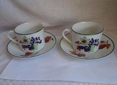 A Pair of Royal Worcester Evesham Vale Cups and Saucers