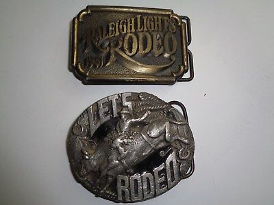 2 Vintage Rodeo Belt Buckles #A258 Bucking Bull &  1981 Raleigh Lights Rodeo