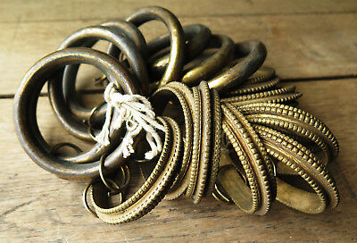 A Collection Of Antique Brass Curtain Rings