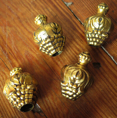Four Antique Gilt Brass  Curtain Pulls