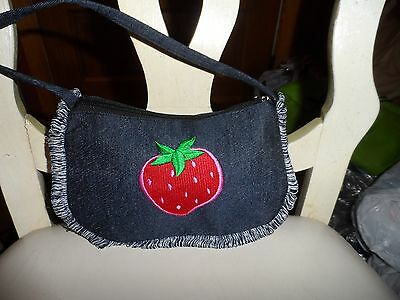 Small dark blue denim handbag with strawberry accent