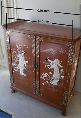 Antique Chinese Wine Cabinet with carved figures and matching coffee table