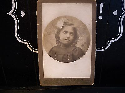 Antique Victorian/ Edwardian cabinet photograph Child with bow