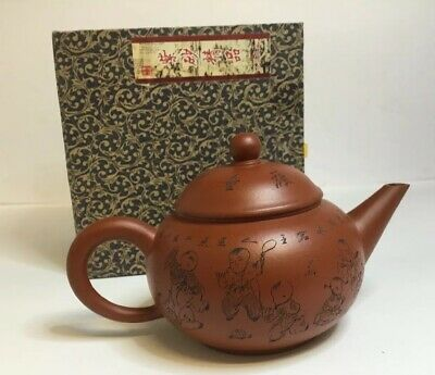 A CHINESE YIXING RED CLAY TEAPOT BOXED With Seal / Character Mark and Seal