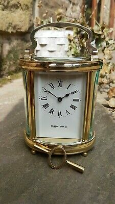 A beautiful oval cased eight day carriage clock by Mappin and Webb - Quality