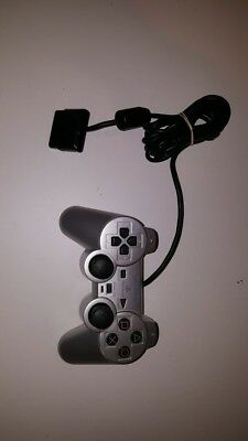 Sony Playstation original silver dual shock controller