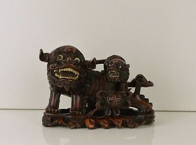A Superb Chinese Wooden Carving Of Foo Dogs