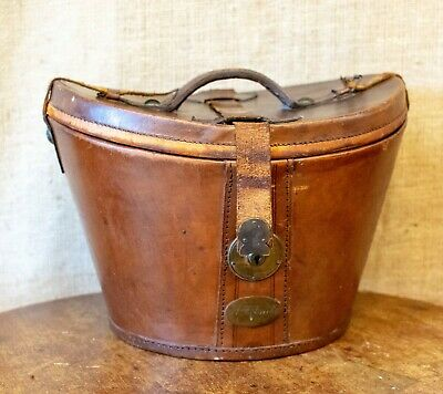 Vintage leather hat box with black top hat by Hanbridge of Norfolk,