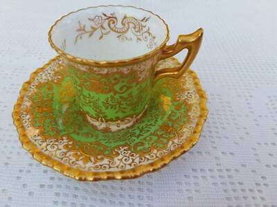 Antique Coalport Richly raised gold Green Demitasse cup & saucer