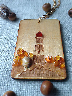 Wooden necklace pendant with lighthouse decorated with genuine Baltic amber.